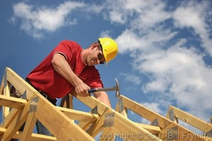 Contruction worker on roof truss